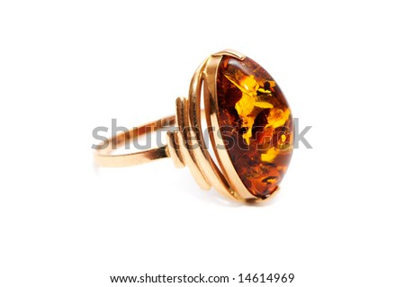 Gold ornaments with amber isolated on a white background - stock photo