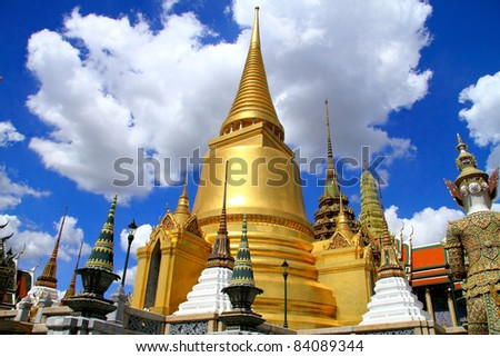 Gold pagoda, white cloud and blue sky at Wat Phra Kaew Grand Palace in Bangkok, Thailand - stock photo