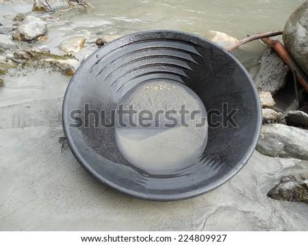 gold panning - stock photo