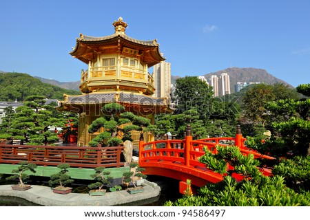 gold pavilion in chinese garden - stock photo