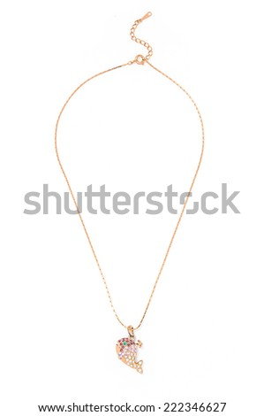 gold pendant with whale on a white background - stock photo