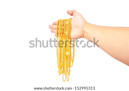 gold pendants in hand on white background - stock photo
