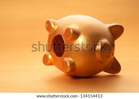 Gold piggy bank on white background - stock photo