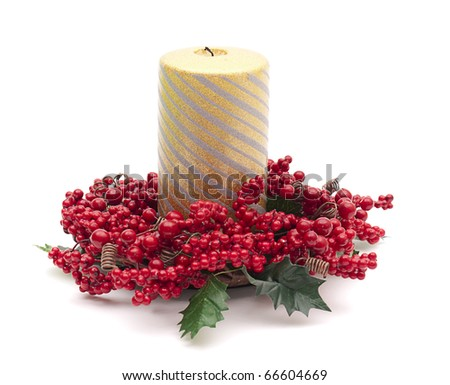 Gold pillar candle in ring of berries - stock photo