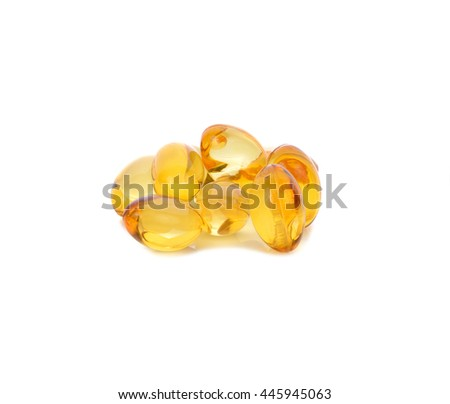 gold pine oil supplement capsules isolated on a white background. - stock photo