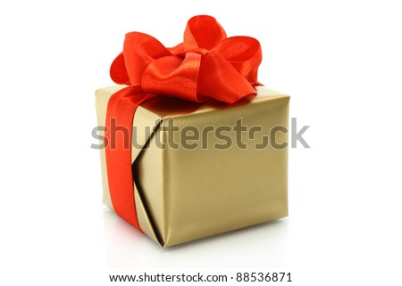 Gold present box with red bow on a white background - stock photo