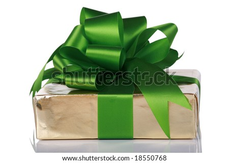 Gold present wrapped with green ribbons and bow - stock photo