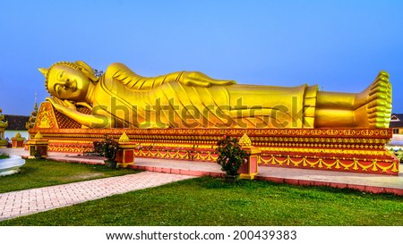 Gold reclining Buddha,Lao, Vientiane - Wat Si Saket temple. Built between, 1819 and 1824 by Chao Anon, is believed to be Vientiane's oldest surviving temple. - stock photo