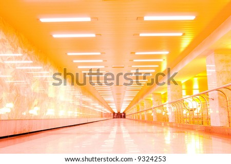 Gold reflection on marble floor in moscow metro - stock photo