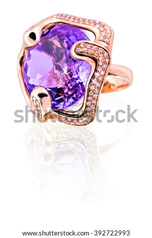 Gold ring in the shape of a flower with amethyst and diamonds  - stock photo