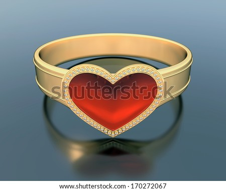Gold ring with a heart shape ruby - stock photo