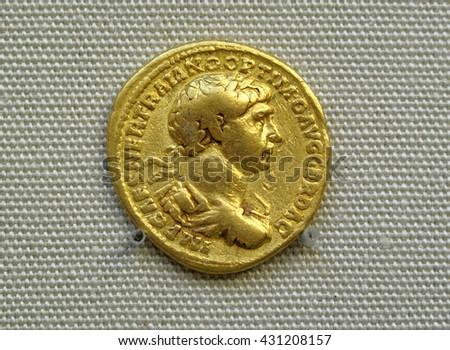 Gold Roman aureus coin of Roman emperor Trajan, Roman empire AD 98-117 - stock photo