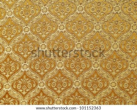 Gold seamless Thailand pattern on fabric - stock photo