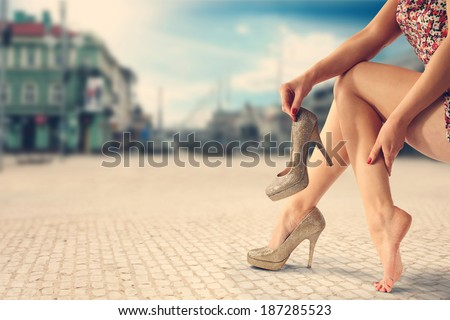 gold shoes and city - stock photo