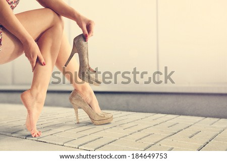 gold shoes and woman legs  - stock photo
