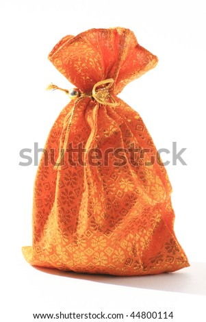 Gold silk pouch isolated on a white background, Thailand. - stock photo