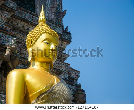 gold statue in the temple. - stock photo
