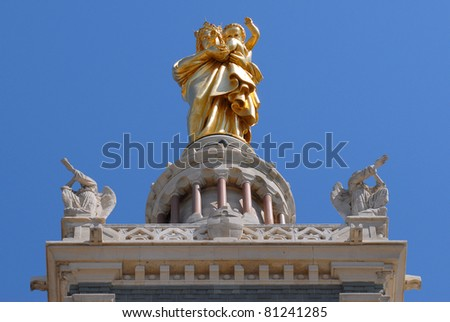 Gold statue of Mary and child front view on top of the basilica Notre-Dame de la Garde at Marseilles in south of France. Department Bouches-du-Rhône, region Provence-Alpes-Côte d'Azur - stock photo