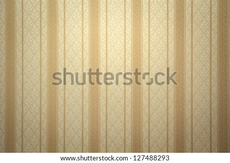 Gold striped wallpaper with copy space - stock photo