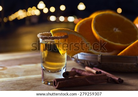 Gold tequila with orange, cinnamon and sugar - stock photo