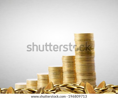 gold the coins and the graph them  - stock photo