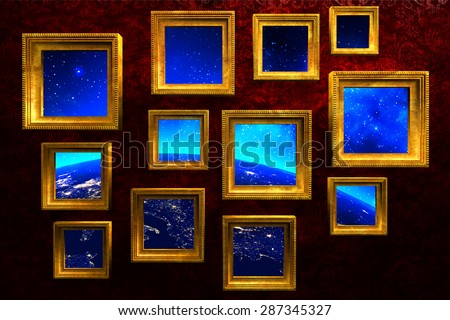 Gold vintage picture frames with earth, stars and space photo collage, art gallery on red grunge wall background (Elements of this image furnished by NASA) - stock photo