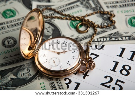 gold watch and dollar bills close up - stock photo