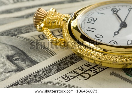 gold watch on dollar money banknotes - stock photo