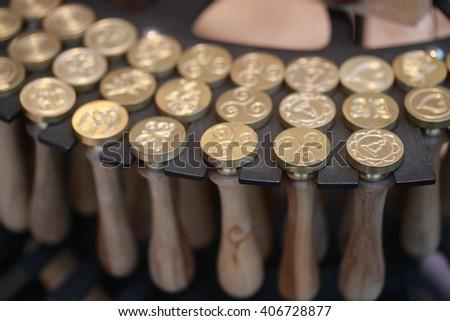 gold wax stamper on letter envelop  - stock photo
