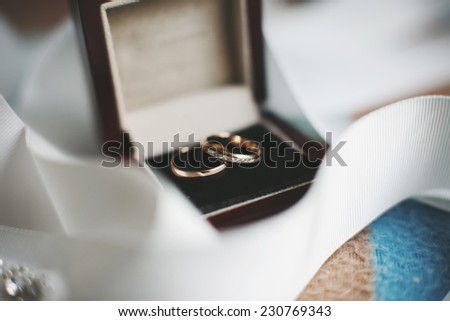 Gold wedding rings in a box - stock photo