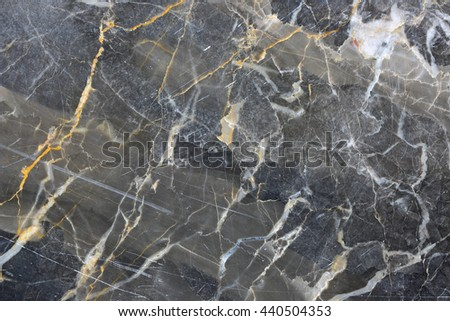 Gold yellow and white patterned natural of dark gray marble pattern texture and background for design product. - stock photo