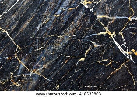 Gold yellow patterned natural of dark gray marble pattern for texture and design - stock photo