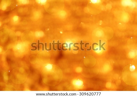 Golden abstract background with bokeh defocused lights and stars. - stock photo