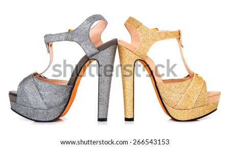 Golden and grey luminous woman shoes isolated on the white background - stock photo