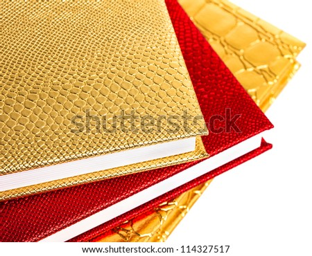 Golden and red notebooks isolated - stock photo