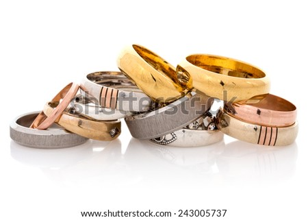 Golden and silver  jewelry on the white background - stock photo