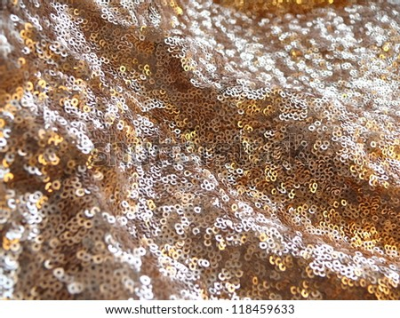 Golden and silver sequins. More of this motif and more backgrounds in my port. - stock photo