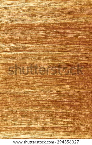 Golden antique grunge crumpled crepe paper texture, natural textured background, vertical copy space, dark sepia macro - stock photo