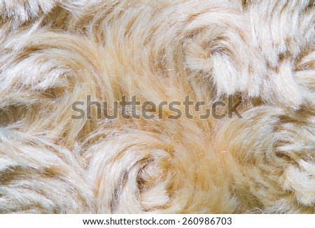 golden artificial fur texture for background - stock photo