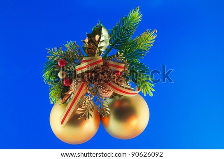 golden balls, cone spruce, fir and sprigs to decorate for Christmas against a blue background - stock photo
