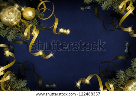 Golden baubles and ribbons on a dark blue background - stock photo