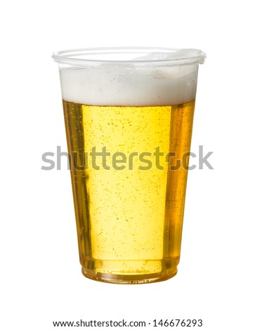 Golden beer, ale or lager in a plastic disposable cup or glass for party concert or by pool for safety - stock photo
