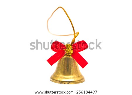 golden bell with red ribbon closeup on white - stock photo