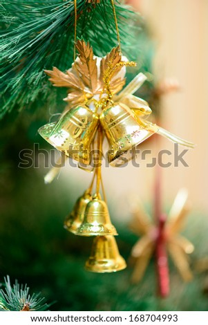 golden bells decorations on Christmas tree. new year - stock photo
