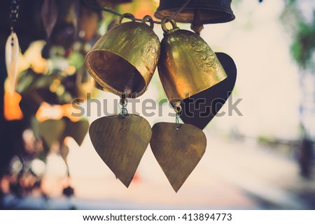 Golden Bells in Buddhist temple of Thailand , Vintage color filter - stock photo