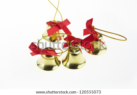 golden bells with a red bow. isolated on white. - stock photo