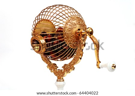 golden bingo sphere with wooden balls on white background - stock photo