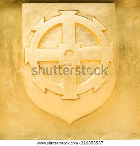 Golden Blazon of Mulhouse, coat of arms, with wheel of mill, France - stock photo