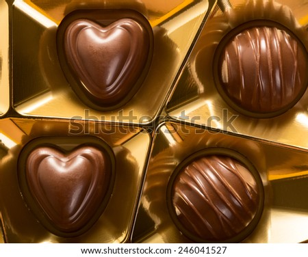 Golden box of chocolate candy showing love concept - stock photo