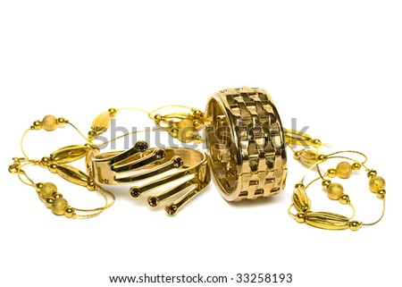 golden bracelets with beads isolated on white background - stock photo